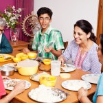 Cheerful Asian Indian Family Enjoying Meal Together
